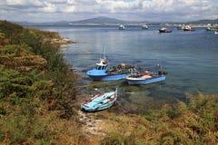 三个蓝色渔船 免版税库存图片