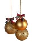 三个金子圣诞节球 免版税图库摄影