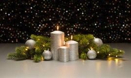 三个银色蜡烛 免版税库存图片