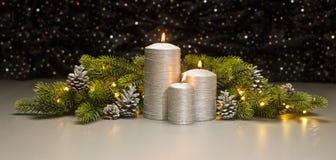 三个银色蜡烛 免版税库存照片