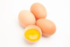 三个鸡蛋用在一半的卵黄质壳 库存图片