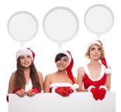 三个年轻人圣诞老人有想法的轻快优雅和空的蟒蛇的帮手女孩 免版税库存照片