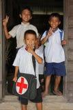 三个年轻男孩姿势在学校 图库摄影