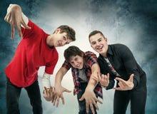 三乐趣Hip Hop姿势的年轻人 免版税图库摄影