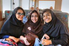 三位伊朗女小学生画象在船上运送,南部的红外线 免版税库存照片