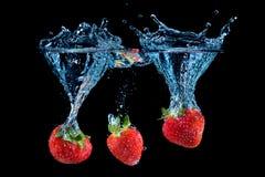 三倍草莓飞溅 图库摄影