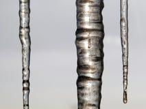 三冰柱垂直在多云天空背景  免版税图库摄影