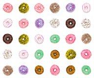 三十个五颜六色的油炸圈饼 免版税库存图片