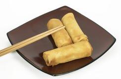 三双蛋卷和筷子 免版税库存照片