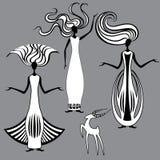 三名优美的妇女和山羊 免版税库存图片