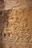 三名跳舞的妇女的石浅浮雕,吴哥窟,柬埔寨 库存照片