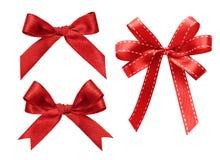 三在白色红色丝带隔绝的种类 免版税图库摄影