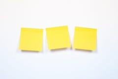 三在白色背景的黄色贴纸, 图库摄影