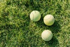 三在草坪的网球 库存照片