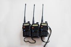 三在钢背景的手提电话机发射机 库存图片