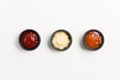 三在黑碗的调味汁 免版税库存照片