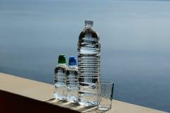 三块塑料瓶和玻璃 库存照片