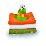 三块毛巾和自然肥皂 免版税图库摄影