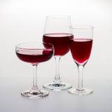 三块玻璃用红葡萄酒 免版税库存图片