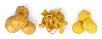 三堆在白色的土豆,被剥皮的和被剥皮的土豆, 顶视图 图库摄影