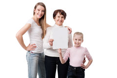 三妇女拿着空白的委员会的一代 库存图片