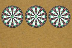 三孤立掷镖的圆靶 库存图片