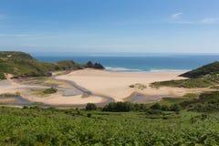 三峭壁海湾南海岸高尔半岛斯旺西威尔士英国 库存图片