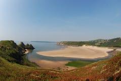 三峭壁海湾, Gower 图库摄影