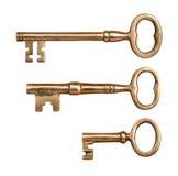 三把古色古香的黄铜钥匙 库存照片