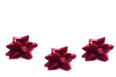 三把圣诞节红色弓 免版税库存照片