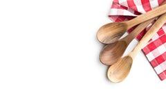 三把木匙子和方格的餐巾 库存照片