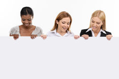 三拿着白板的女实业家 免版税库存图片