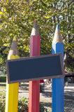 三支色的铅笔在庭院里 库存图片