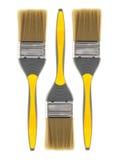 三支黄色画笔 免版税图库摄影