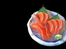 三文鱼生鱼片在与山葵或日本马的冰块服务 库存照片