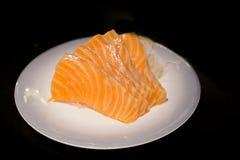 三文鱼生鱼片被隔绝的背景 库存图片