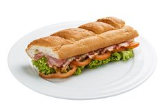 三明治用火腿、蕃茄和绿色 库存图片