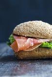 三明治有黑暗的背景 库存照片