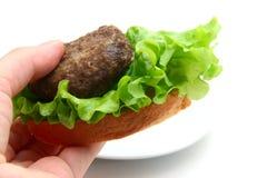 三明治用炸肉排在手中 图库摄影