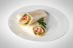 三明治皮塔饼小圆面包用火腿 免版税库存照片
