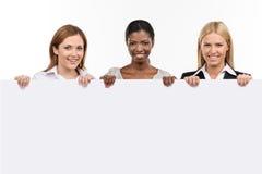 三有白板的女实业家 库存照片