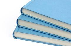 三本蓝皮书爱好者在白色背景的 免版税库存图片