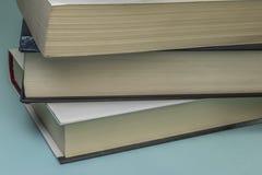三本被堆积的书 库存图片