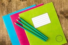 三本练习簿和三支铅笔 图库摄影