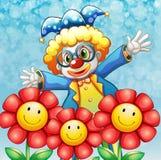 三朵可爱的花的后面的一个小丑 免版税库存图片