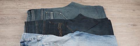 三条不同蓝色牛仔裤 库存照片