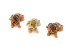 三条狗孩子的长毛绒玩具 免版税库存图片