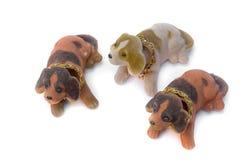 三条狗孩子的长毛绒玩具 免版税库存照片