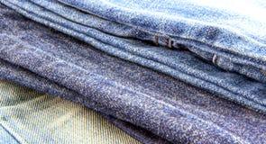 三条蓝色牛仔裤另外纹理  免版税库存照片