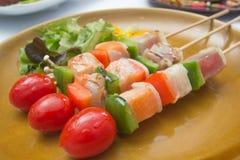 三条调味的鱼烤肉 免版税库存照片